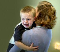 Parent calming an upset child