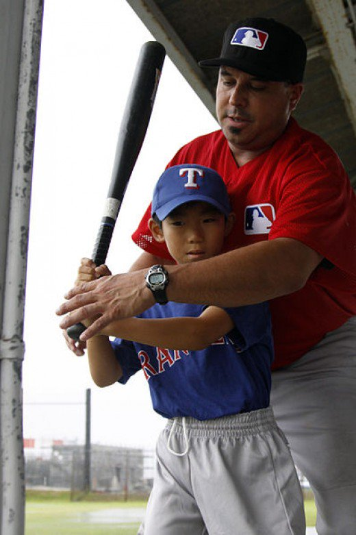 Teaching a boy to bat