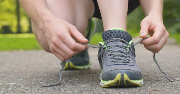 Putting on running shoes