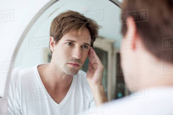 man looking in a mirror