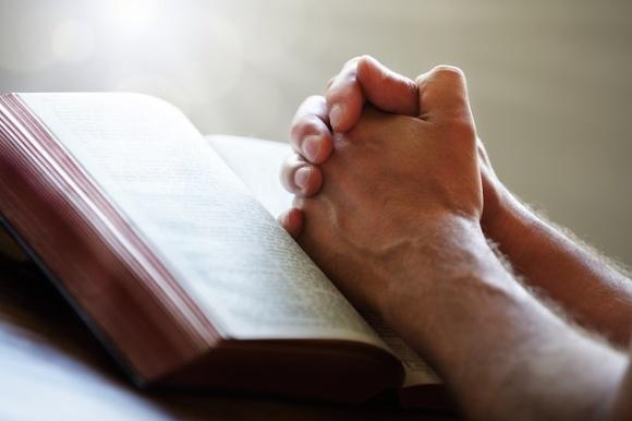 Preacher praying.jpg